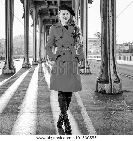 Young Woman On Pont De Bir-hakeim Bridge In Paris