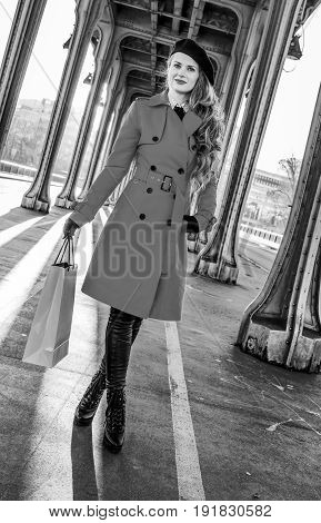 Woman On Pont De Bir-hakeim Bridge In Paris With Shopping Bag