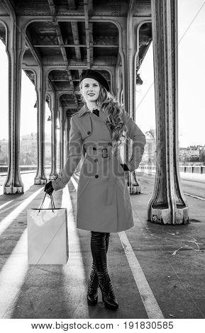 Traveller Woman On Bridge In Paris Holding Shopping Bag