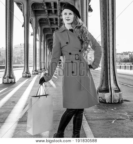 Tourist Woman On Pont De Bir-hakeim Bridge With Shopping Bag