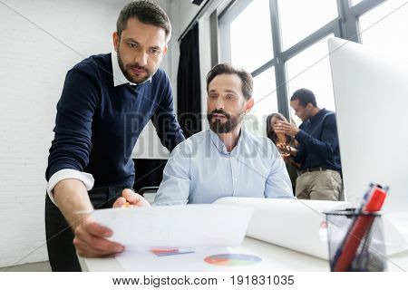 Focused business team working with documents in an office