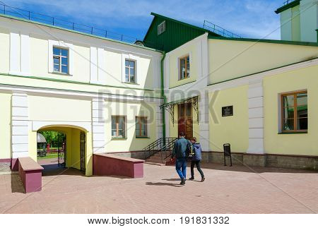 POLOTSK BELARUS - MAY 19 2017: Polotsk State University Faculty of Information Technologies (complex of buildings of former Jesuit collegium) on Streletskaya Street. Unidentified students go in courtyard of university