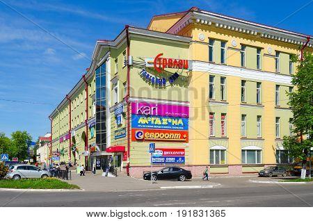 POLOTSK BELARUS - MAY 19 2017: Unknown people are walking along avenue of Francysk Skaryna near Trade House