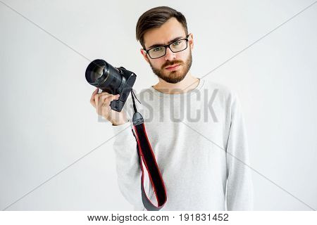 Photographer with a camera on a white background isolate