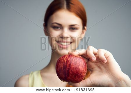 Food, apple, diet, healthy food, woman with apple on gray background.