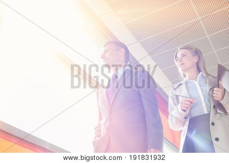 Low angle view of business people walking in railroad station