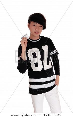 A handsome young Asian teenager standing in a black t-shirt holding his credit card to spend money isolated for white background.