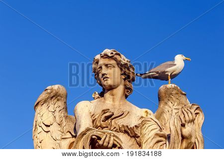 Sculpture of an angel on a bridge across the Tiber in Rome. Italy.