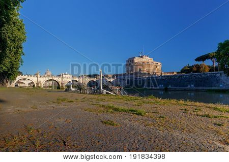 The bridge of Sant'Angelo across the Tiber River at dawn. Rome. Italy.
