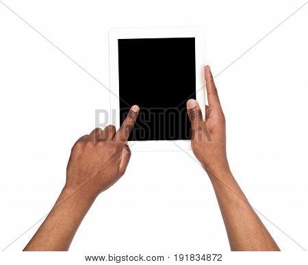 Holding and pointing to blank screen on digital tablet. African american man using device with blank screen, copy space for advertisement, isolated on white background