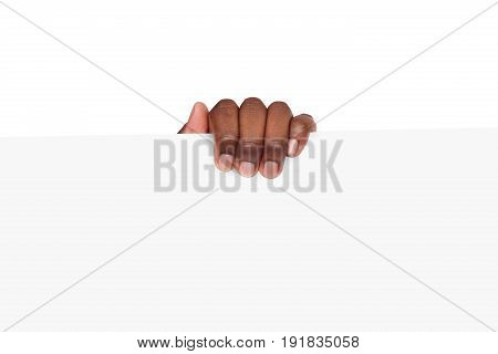 Black hand with blank advertising card. African american man holding empty paper, isolated on white background, copy space