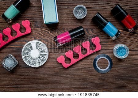 manicure set and nail polish for hands treatment on wooden desk background top view