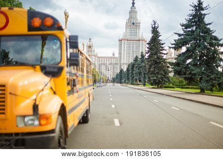 American yellow school and student bus in Moscow against the background of university MSU