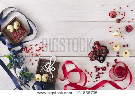Making jewelry, home workshop background. Flat lay, tools and materials for creating accessory with beads and ribbons, top view, copy space. Beauty, creativity, handicraft concept