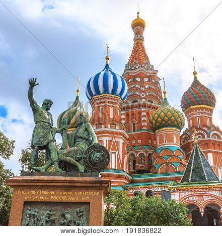 St. Basils cathedral and monument to Minin and Pozharsky on Red Square in Moscow, Russia The translation of the words on monument is 'To Citizen Minin and prince Pozharsky from thankful Russia. Year 1818'