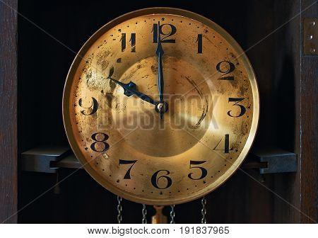 Vintage style grandfather clock clockface in dark wood