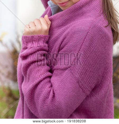 Red Knit Cardigan On The Girl With Long Hair, And Painted Pink Lips