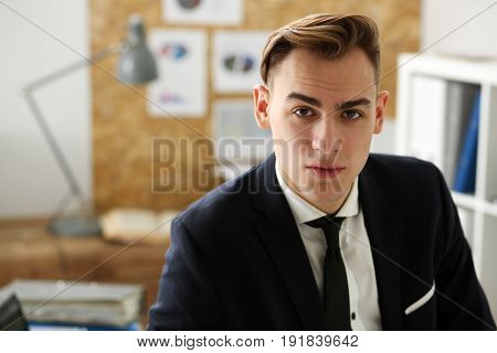 Handsome Businessman In Suit Portrait At Workplace