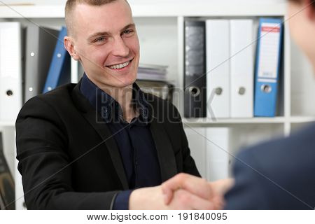Smiling Businessman Shake Hands As Hello In Office