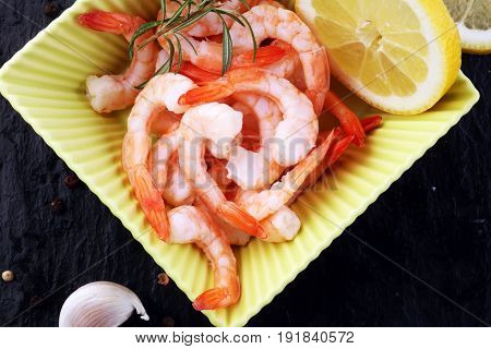 Delicious Sauteed Shrimps With Cajun Seasoning And Lime On Dark Stone