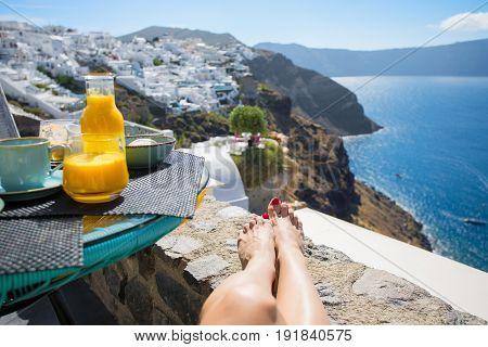 Woman enjoying the morning view in beautiful Santorini
