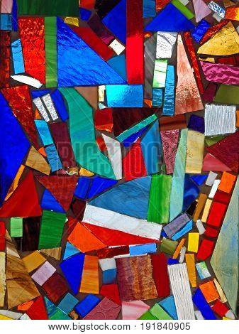 vertical photo of colors and shapes in a stained glass window
