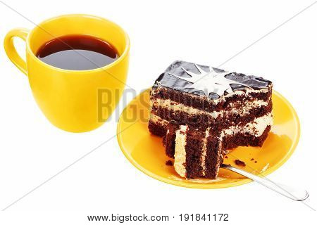 Cup of tea and chocolate cake with spoon on plate isolated on a white background