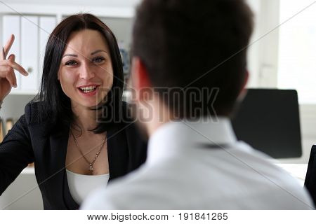 Beautiful Smiling Woman Talk To Male Visitor