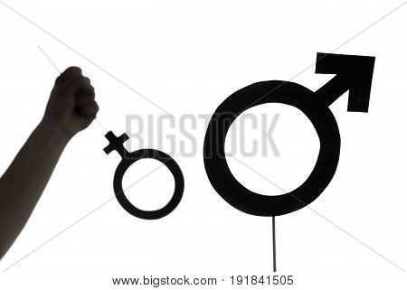 Male chauvinism, woman rights and gender equality concept. Also domestic abuse and family violence or battering concept. Violent and powerful man holding, throwing or hitting female symbol. Silhouette