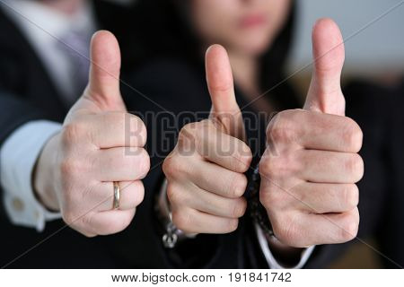 Group Of People Showing Ok Or Approval Sign With Thumb Up