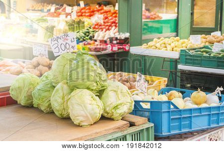 Pile of cabbage in farmer's market table. Healthy vegetables in sale outdoor in Poland. Local fresh ingredients.