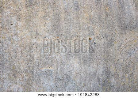 Old concrete wall with cracks and chipped