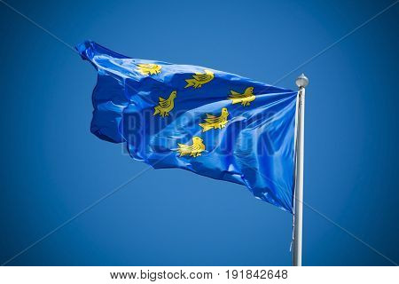 Sussex flag on sunny day against clear blue sky