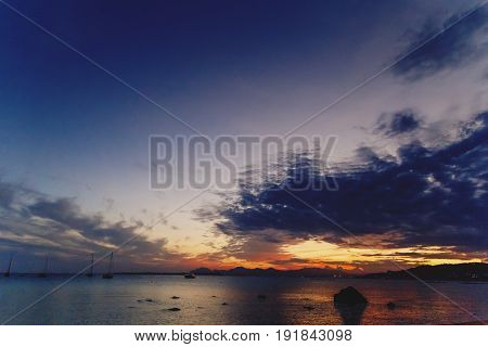 JUAN LES PINS FRANCE - September 20th 2016: Majestic sunset on the Mediterranean sea shot in Juan Les Pins on the French Riviera