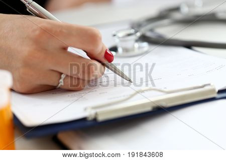 Female Doctor Hand Hold Silver Pen