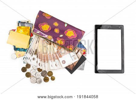 The tablet cash coins credit cards and purse on a white background.