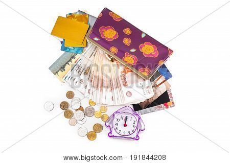 Watches cash coins credit cards and purse on a white background.