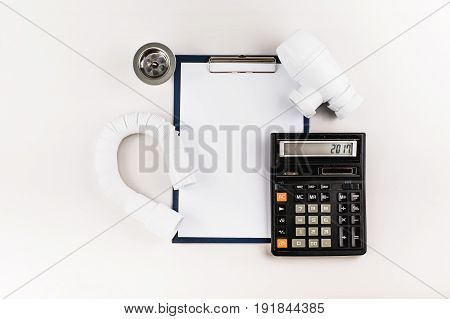 Folder with clip calculator and plumbing supplies.