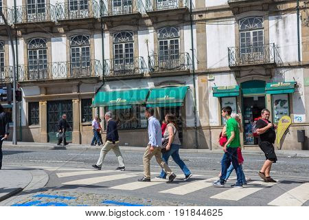 PORTO, PORTUGAL - April 17, 2017: People walking at Old Town streets of Porto. Porto is the famous tourist destiantion in Portugal