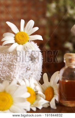 Lovely themed image of effective spa treatments using Chamomile.