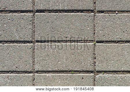 Street road bricks. Texture of ground with gray stones