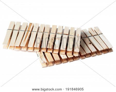 Two dozen clothespins are on the table. White background.