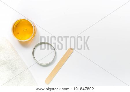 Wax and sticks for depilation on white background top view copyspace.