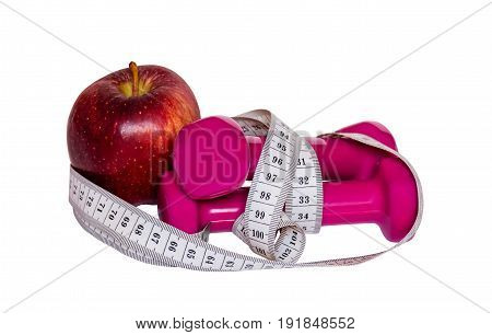 Dumbbells red apple and measure tape isolated on white background