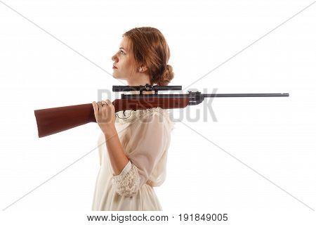 A lady wearing a white dress holding a rifle over her shoulder