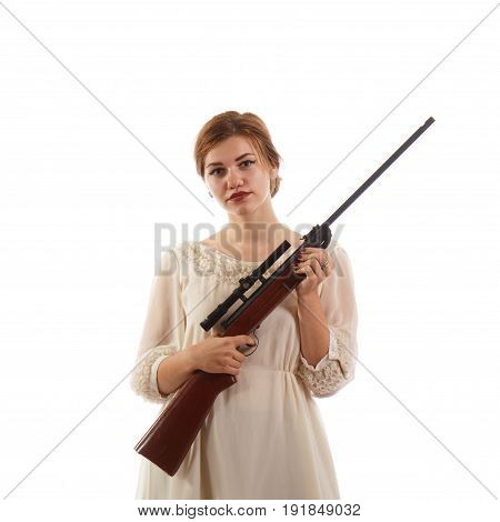 A young lady wearing a white dress holding a rifle