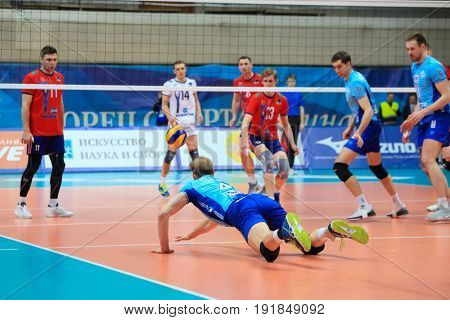 MOSCOW - APR 8, 2017: Player does dig at match of Russian Volleyball Championship Dynamo (Moscow) - Nova (Novokuibyshevsk) in Palace of Sports Dynamo