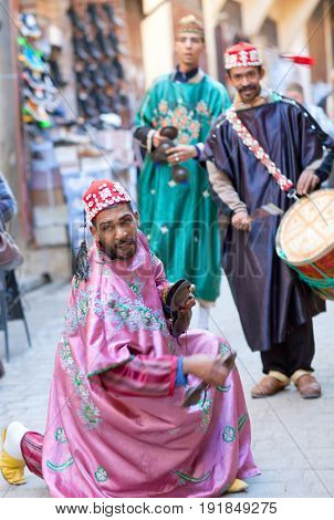 Musicians Playing Traditional Instruments In The Street For Tourists And Shoppers In Fez, Morocco