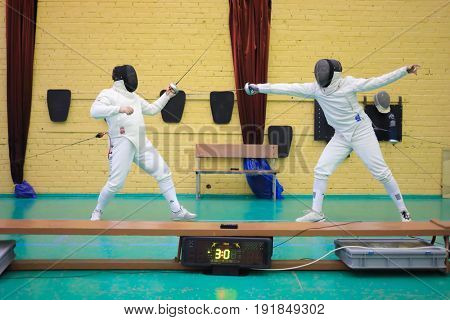 MOSCOW - APR 22, 2017: Duel at Spring Fencing Tournament in club En Garde, En Garde club was founded in 1997 in Department of Fencing of University of Physical Culture, Sports