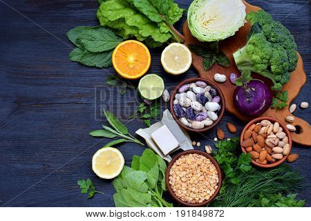 Composition On A Dark Background Of Products Containing Folic Acid, Vitamin B9 - Green Leafy Vegetab